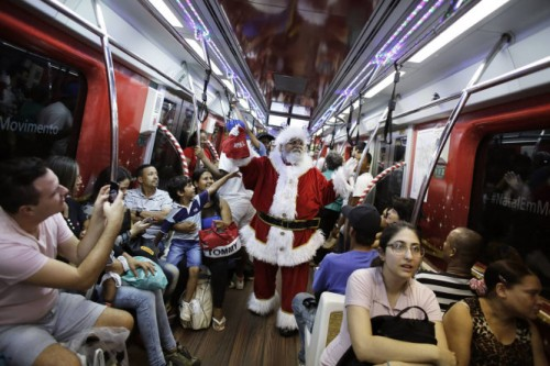 A man, dressed as Santa Claus, rides a subway train as part of a promotional event by a bank in Sao Paulo
