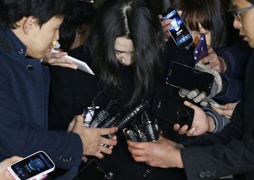 Heather Cho is surrounded by media as she leaves for a detention facility after a court ordered her to be detained, at the Seoul Western District Prosecutor's office